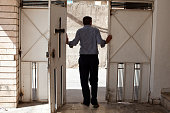 An Iraqi Christian man stands in the doorway of a church where he's seeking refuge in the Kurdish city of Sulaimaniyah On June 10th ISIS fighters...
