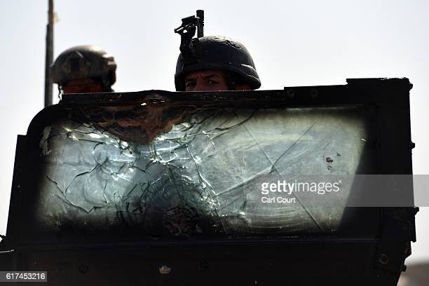 An Iraqi counter terrorism soldier looks over the broken glass shield of his armoured vehicle during the offensive to recapture the city of Mosul...