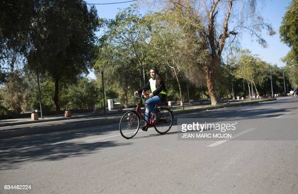 An Iraqi cyclist arrives for a gathering during the second Baghdad Marathon for Peace in Iraq in the Iraqi capital Baghdad on February 4 2017 Marina...
