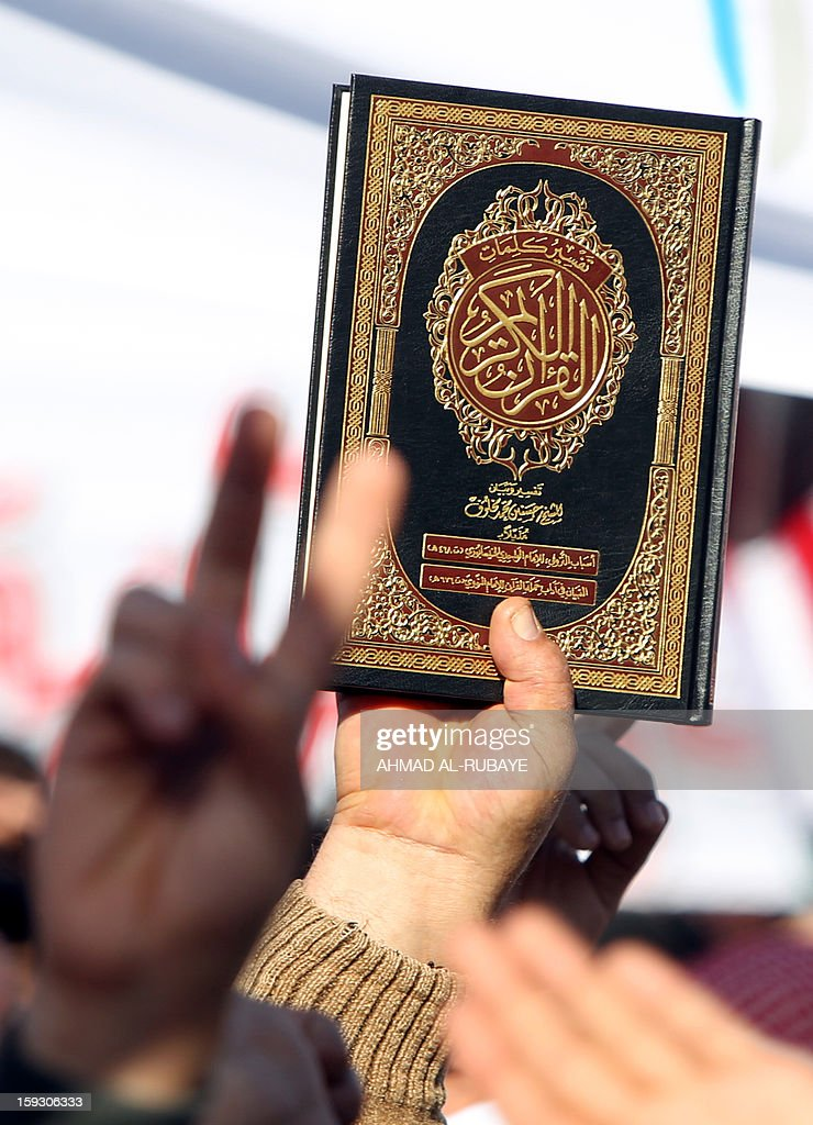 An Iraqi demonstrator holds a copy of the Koran, Islam's holy book, during an anti-government protest outside the Sunni Umm al-Qura mosque in Baghdad on January 11, 2013. Thousands of Sunni Muslims took to the streets of Baghdad and other parts of Iraq to decry the alleged targeting of their minority, in rallies hardening opposition to the country's Shiite leader.