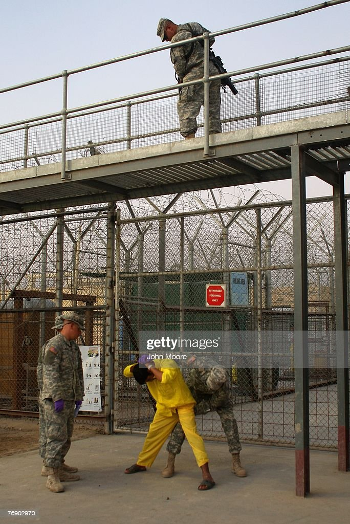 An Iraqi detainee is bodysearched by U.S. Army guards before being taken for an appointment at the Camp Cropper detention center September 20, 2007 in Baghdad, Iraq. The U.S. military has a total of about 25,000 detainees in several centers in Iraq, up from only about 14,000 before the American troop surge this year. The detainee population includes more than 800 juveniles, insurgents from all anti-coalition groups in Iraq, Al Qaeda foreign fighters, criminals, and many innocent Iraqis caught up in U.S. military raids.