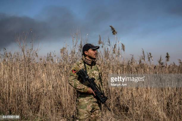 An Iraqi Emergency Response Division soldier advances through farmland along the Tigris River to the southernmost Islamic State occupied...