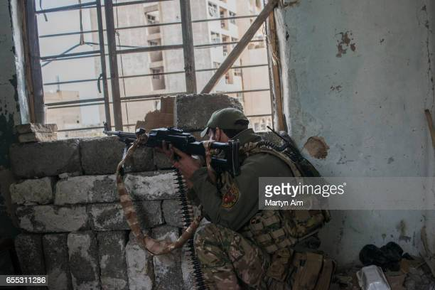 An Iraqi Emergency Response Division soldier fires his machinegun at an Islamic State position in Bab alTob a neighbourhood in the Old City of west...
