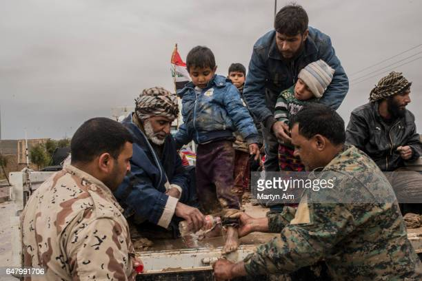 An Iraqi family who have fled fighting as Iraqi forces advance into Islamic State controlled west Mosul March 4 2017 Iraqi forces have encountered...