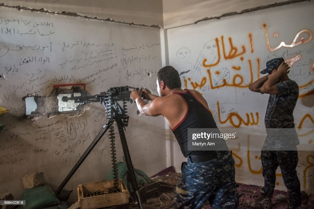 An Iraqi Federal Police soldier fires a 50. calibre machine at Islamic State militants in Bab Jded, west Mosul, Iraq on June 21, 2017. Islamic State occupy houses on a street parallel to the Federal Police position, the beginning of the Old City district of west Mosul.