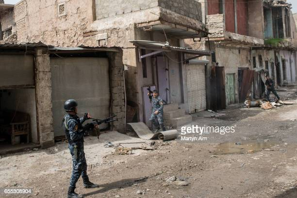An Iraqi Federal Police soldier fires his machinegun at an Islamic State position in Bab alTob a neighbourhood in the Old City of west Mosul part of...