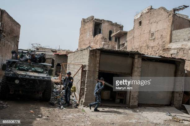 An Iraqi Federal Police soldier runs towards an Islamic State position carrying an RPG grenade launcher in Bab alTob a neighbourhood in the Old City...