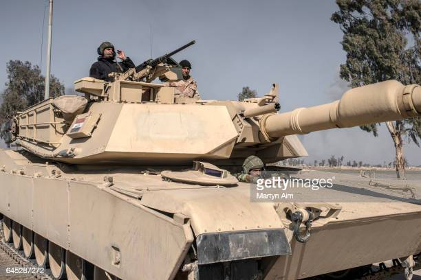 An Iraqi forcces tank crew advance into west Mosul part of the offensive to retake the city some two years after it fell to Islamic State February 25...