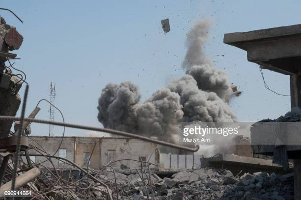 An Iraqi forces airstrike targets an Islamic State sniper position June 17 2017 in alShifa the last district of west Mosul under Islamic State...