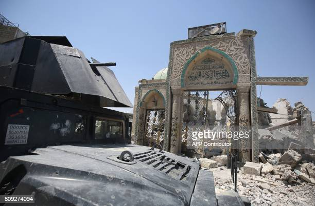An Iraqi forces' humvee lies parked outside the destroyed gate of AlNuri Mosque in the Old City of Mosul on July 5 2017 during the Iraqi government...