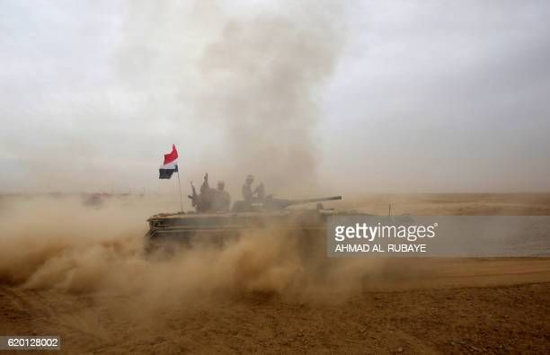 TOPSHOT An Iraqi forces tank advances towards the village of Abu Shuwayhah south of jihadistheld Mosul on November 1 during the ongoing operation to...