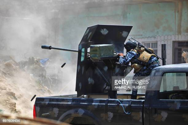 TOPSHOT An Iraqi forces member fires a 23 mm antiaircraft gun as they advance towards the Old City of Mosul on June 19 2017 during an ongoing...