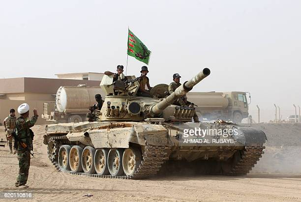 An Iraqi forces tank advances towards the village of Abu Shuwayhah south of Mosul on November 1 during the ongoing operation to retake the last major...