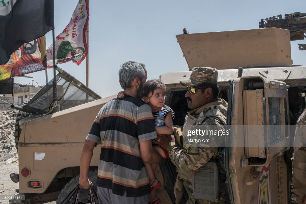 An Iraqi girl clings to her father after her family fled the Islamic State controlled Old City of west Mosul where heavy fighting continues on June 23, 2017. Iraqi forces continue to encounter stiff resistance with improvised explosive devices, car bombs, heavy mortar fire and snipers hampering their advance.