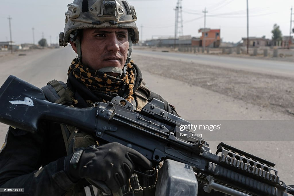 An Iraqi Golden Division soldier stands guard on October 27, 2016 in Bartella, Iraq. Bartella was recently captured from ISIS by Iraqi Special Forces as they press toward Mosul, which is just some seven miles away from the town.