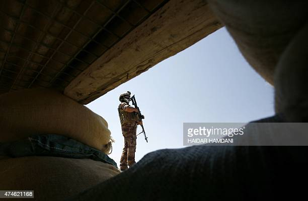An Iraqi government forces member keeps position in the Jurf alSakher area some 50 kilometres south of Baghdad to protect the area from further...