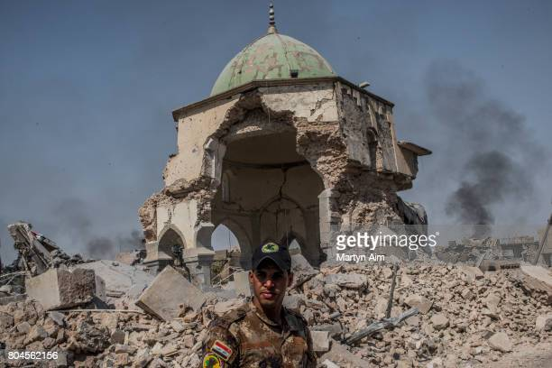 An Iraqi ISOF forces soldier in front of the destroyed alNuri mosque in the Old City of west Mosul where heavy fighting continues on June 30 2017 in...