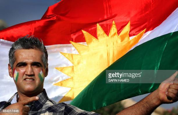 An Iraqi Kurdish demonstrator waves a Kurdish flag during a protest demanding for the independence of Kurdistan outside the United Nations offices in...