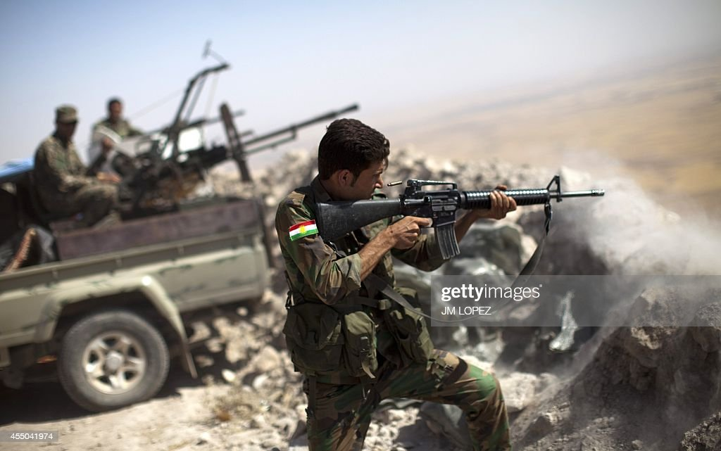 An Iraqi Kurdish Peshmerga fighter fires at Islamic-State (IS) militant positions, from his position on the top of Mount Zardak, a strategic point taken 3 days ago, about 25 kilometres east of Mosul on September 9,2014. Kurdish forces in the north have been bolstered by US strikes and took control of Mount Zardak, a strategic site that provides a commanding view of the surrounding area, a senior US officer said.