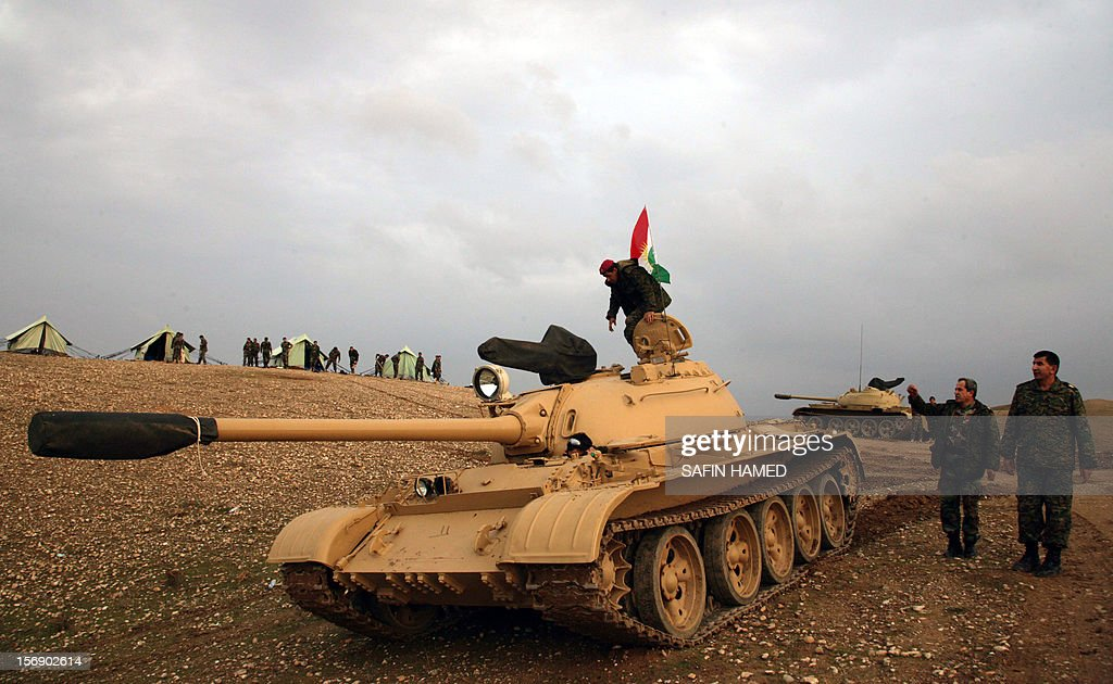 An Iraqi Kurdish peshmerga soldier stands on a tank, flying the Kurdish flag, stationed 20 kilometres north of Kirkuk on November 24, 2012. Iraq's parliament speaker Osama al-Nujaifi said that 'significant progress' has been made on resolving an Arab-Kurd crisis, although a deployment of Kurdish forces in the country's north has raised the stakes.