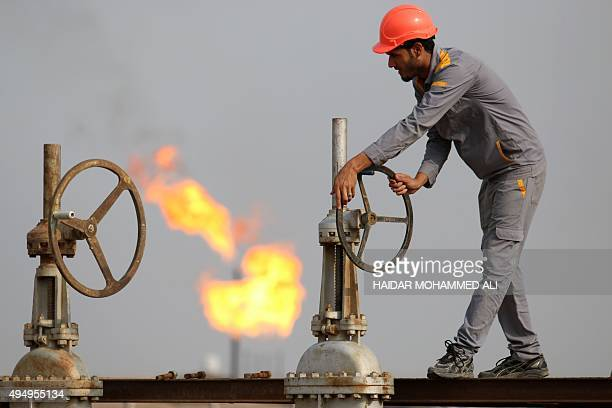 An Iraqi labourer works at an oil refinery in the southern town Nasiriyah on October 30 2015 South Oil Company has raised production at Nasiriyah oil...
