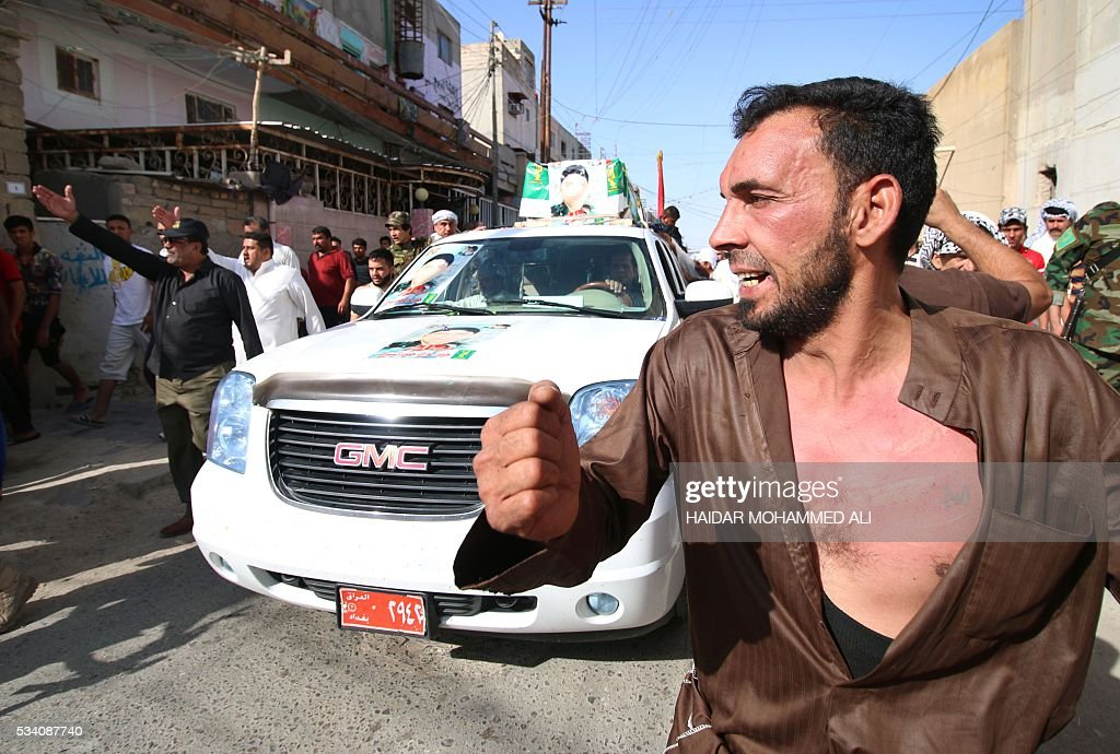An Iraqi man beats himself on the chest as he mourns a relative who was killed fighting alongside Iraq government forces to retake to city of Fallujah from jihadists of the Islamic State group, on May 25, 2016 during a funeral in the southern city of Basra. Iraqi forces battled the Islamic State group in the opening stages of an operation to retake Fallujah, one of the toughest targets yet in Baghdad's war against the jihadists. ALI