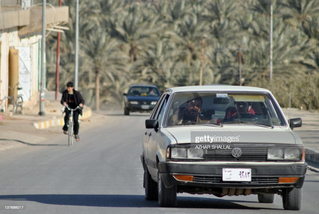 An Iraqi man drives his car on January 24, 2012 through the Askari neighbourhood of Haditha, a town of around 80,000 people in the western Iraq Anbar province, where 24 Iraqis were killed by US troops in 2005. Haditha residents and relatives of those killed by US troops in 2005 have voiced shock and disgust over the light sentence meted out to a US soldier involved in the massacre. AFP PHOTO/ AZHAR SHALLAL