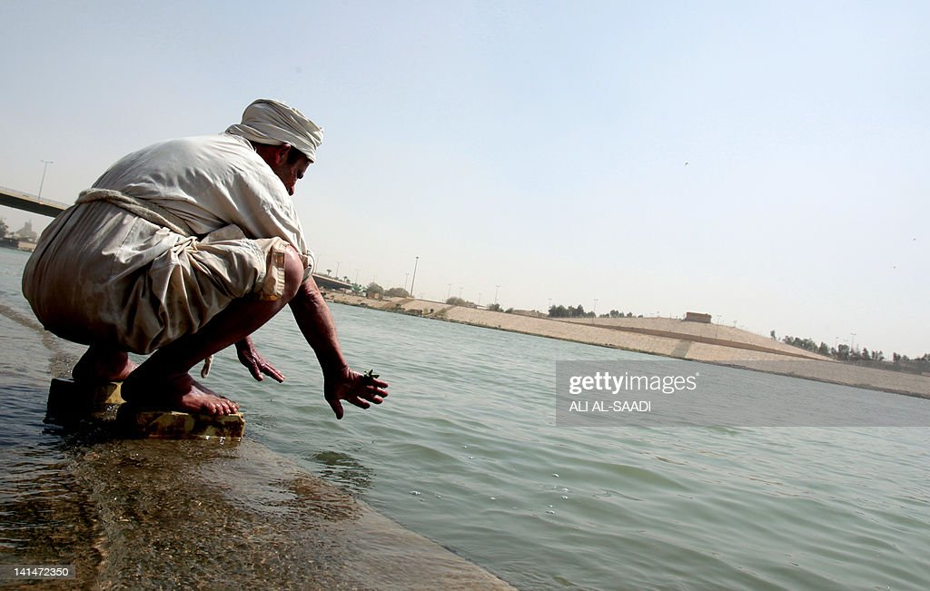 An Iraqi man follower of the Sabean religion a preChristian sect that follows the teachings of John the Baptist washes his hands during a ceremony to...