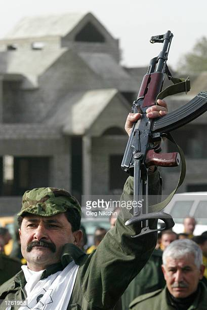 An Iraqi man holds an AK47 rifle during a march in defiance of US threats to invade Iraq February 4 2003 in the city of Mosul 450 kilometers north of...