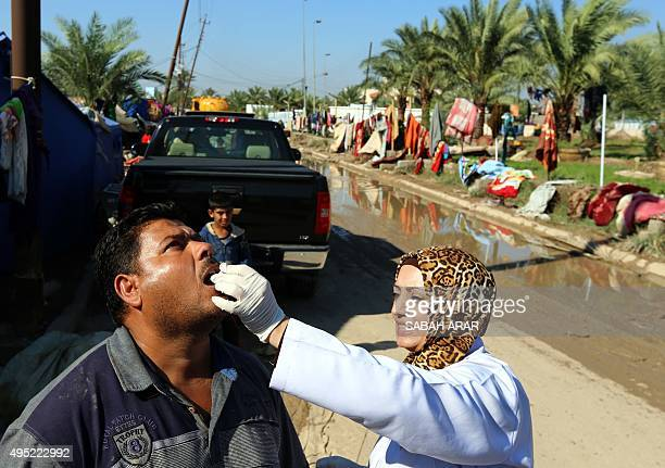 An Iraqi man receives a dose of cholera vaccine at the jamiyah district in Baghdad on November 1 2015 The number of cholera cases in Iraq has risen...