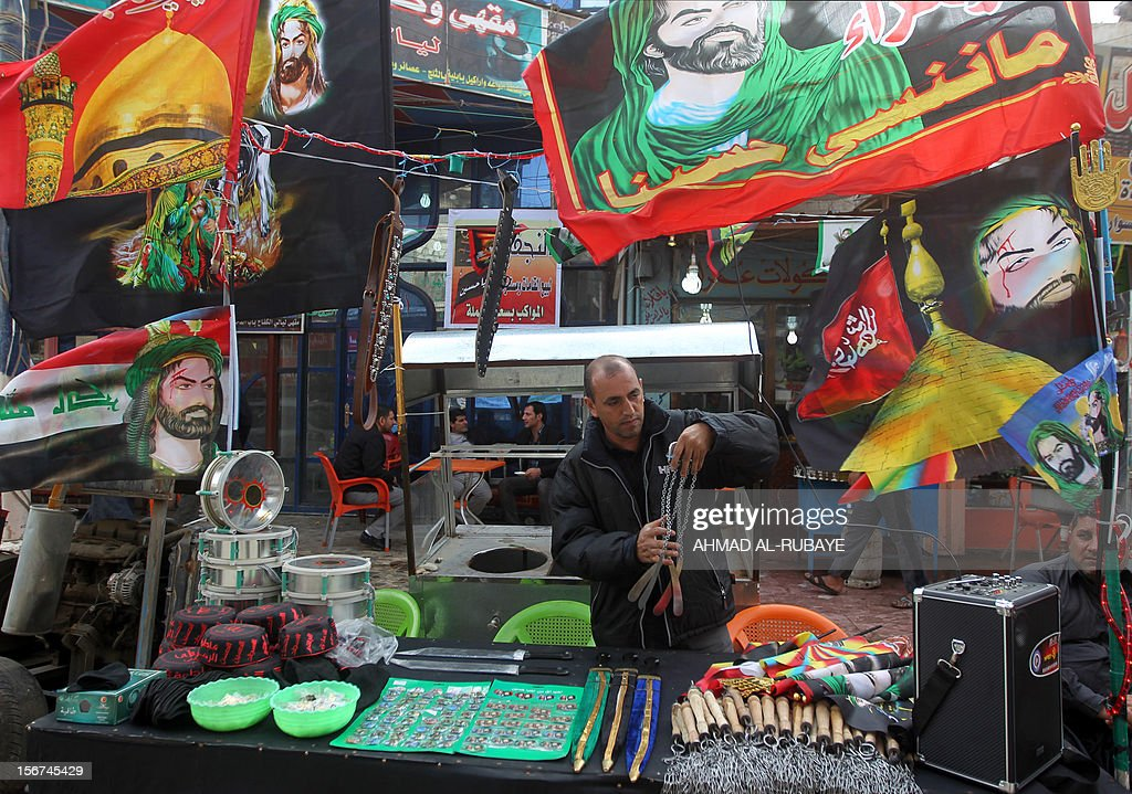 An Iraqi man sells paraphernalia related to the Ashura rituals as Shiite Muslim pilgrims begin to gather for the upcoming remembrance in Baghdad, on November 20, 2012. Ashura mourns the death of Imam Hussein, a grandson of the Prophet Mohammed, who was killed by armies of the caliph Yazid near Karbala in 680 AD.