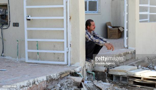 An Iraqi man sits in front of a building as Iraqi Christians family fleeing violence in the northern city of Mosul arrive at Arbil on July 19 2014...