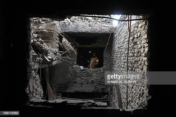 An Iraqi man stands in his house destroyed by a US air strike in 2008 as the US army was fighting radical Shiite cleric Muqtada alSadr's Mahdi...