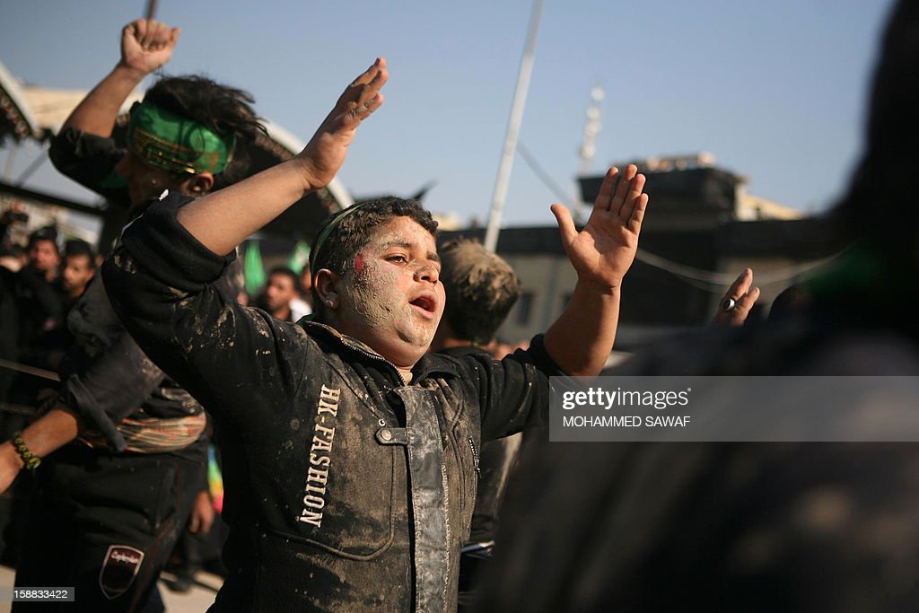 An Iraqi man takes part in the Arbaeen religious festival which marks the 40th day after Ashura commemorating the seventh century killing of Prophet Mohammed's grandson, Imam Hussein, in the shrine city of Karbala, southwest of Iraq's capital Baghdad, on December 31, 2012. A wave of bombings and shootings killed 12 people as Iraq grappled with anti-government protests and simmering political crises ahead of major Shiite Muslim commemoration rituals.