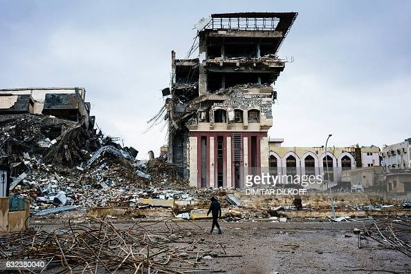 TOPSHOT An Iraqi man walks outside Mosul's University on January 22 a week after Iraqi counterterrorism service retook it from the Islamic State...