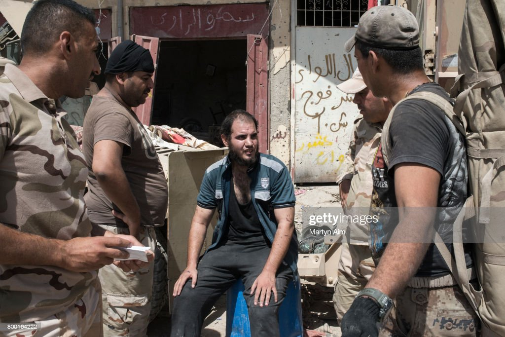 An Iraqi man who has fled the Islamic State controlled Old City of west Mosul where heavy fighting continues is questioned and searched, believed to be a possible Islamic State militant on June 23, 2017. Iraqi forces continue to encounter stiff resistance with improvised explosive devices, car bombs, heavy mortar fire and snipers hampering their advance.