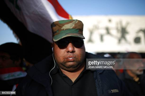 An Iraqi man with duct tape across his mouth takes part in a silent protest of mostly supporters of prominent cleric Moqtada Sadr on February 17 2017...