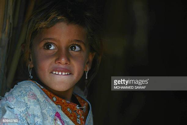 An Iraqi Marsh Arab child smiles at Hor Hamidi 30 kms south of the Souk akShuykh 420 kms south of the capital Baghdad on December 05 2008 The Marsh...