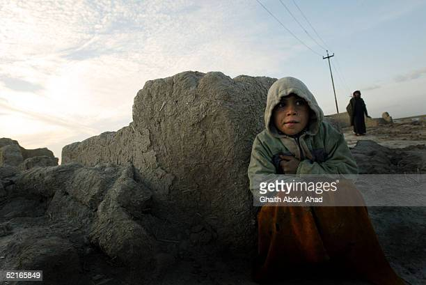 An Iraqi marsh arab girl sits at the ruins of her house February 8 2005 south of the Iraqi city of Ammarah Criminality not insurgency is the biggest...