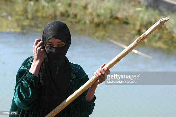 An Iraqi Marsh Arab woman steers her canoe past the reeds at Hor Hamidi 30 kms south of the Souk akShuykh 420 kms south of the capital Baghdad on...