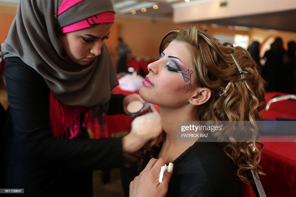 An Iraqi model is made up backstage before a show during a hairdressers and make up artists festival on February 9, 2013 in Baghdad. It is the first time that this kind of festival takes place in the Iraqi capital since 1999.