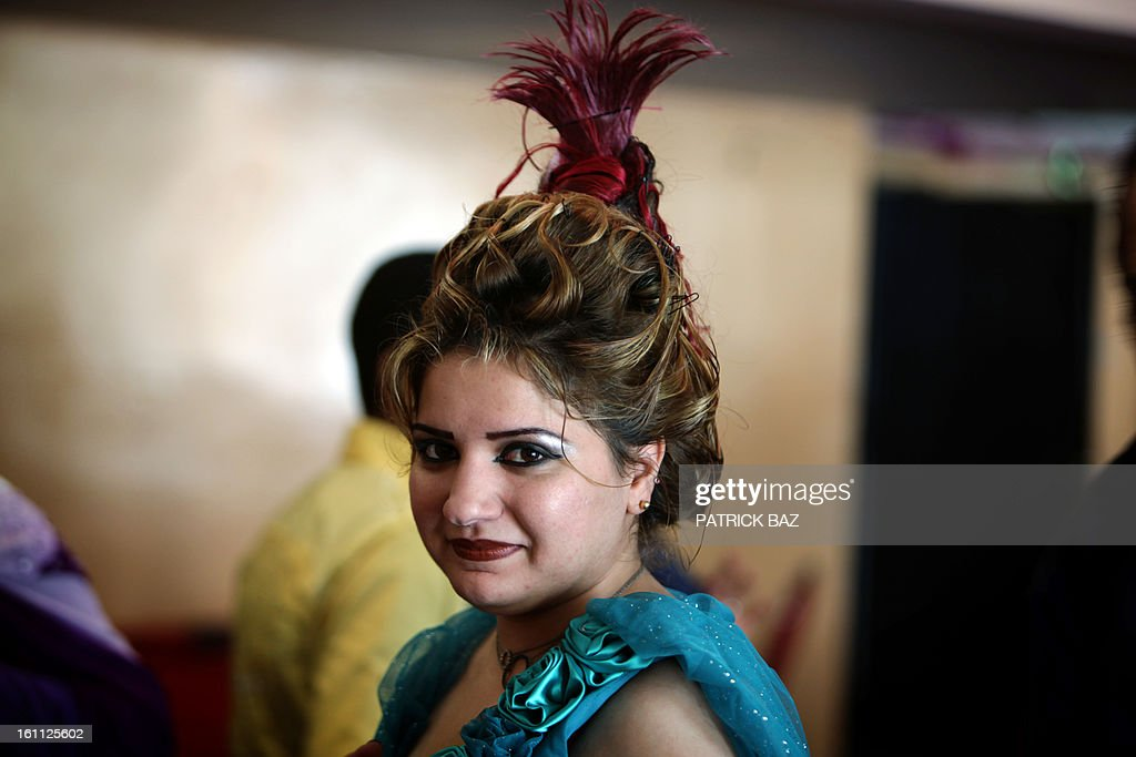 An Iraqi model poses backstage before a show during a hairdressers and make up artists festival on February 9, 2013 in Baghdad. It is the first time that this kind of festival takes place in the Iraqi capital since 1999. AFP PHOTO/PATRICK BAZ