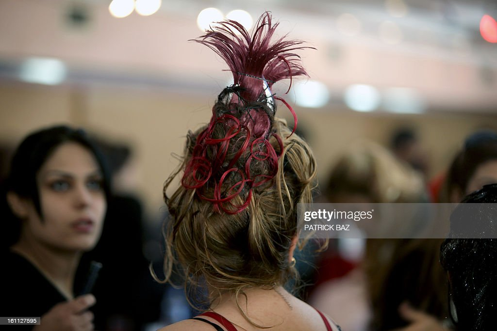 An Iraqi model waits backstage during a hairdressers and make up artists festival on February 9, 2013 in Baghdad. It is the first time that this kind of festival takes place in the Iraqi capital since 1999.