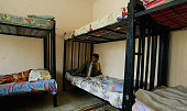 An Iraqi orphan sits in his bed room at the Safe Iraqi Home orphanage on May 20 2007 in the Sadr city Shiite neighborhood in Baghdad Iraq The Safe...