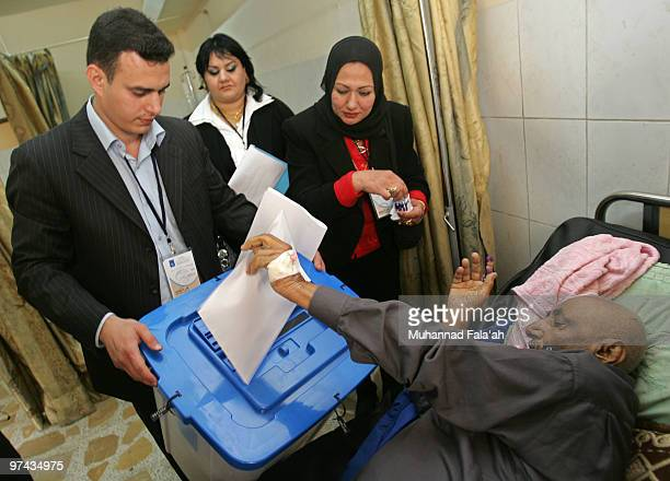 An Iraqi patient casts his ballot in the country's parliamentary elections at a special polling station on March 4 2010 in Baghdad Iraq Special...