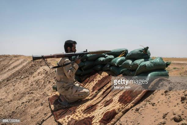 An Iraqi PMF fighter holding an RPG June 20 2017 on the IraqSyria border in Nineveh Iraq The Popular Mobilisation Front forces composed of majority...