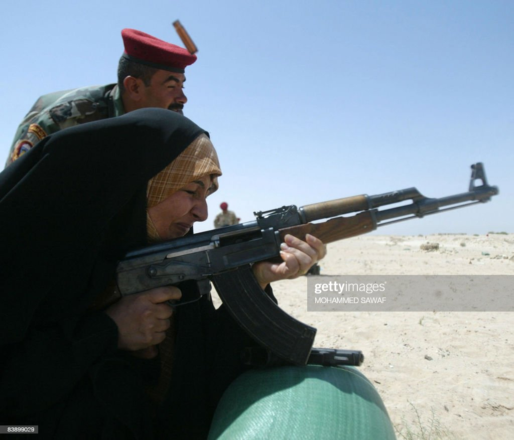 an iraqi policewoman braces from recoil pictures getty images