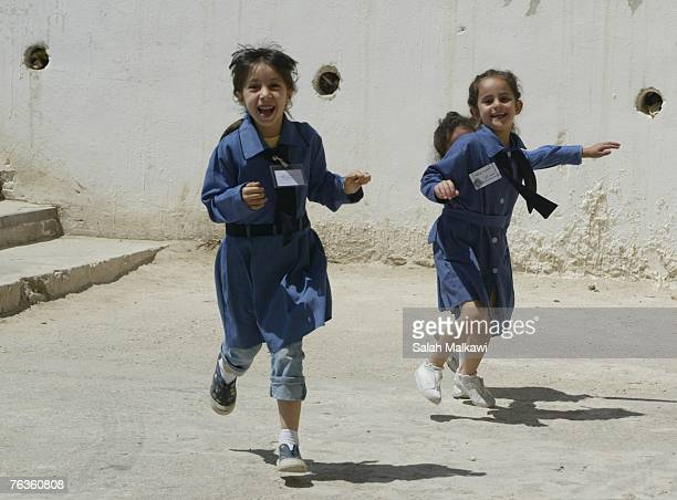 An Iraqi refugee student runs at the Shmeisani elementary school on August 28 2007 in Amman Jordan Ellen Sauerbery Assistant Secretary of State at...