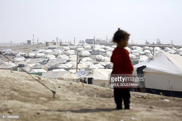 TOPSHOT An Iraqi refugee who fled Mosul the last major Iraqi city under the control of the Islamic State group due to the Iraqi government forces...
