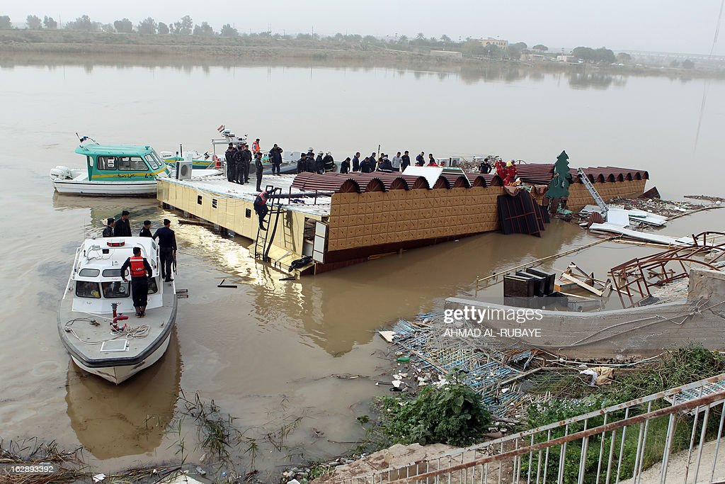 An Iraqi search and rescue team tries to recover the bodies of five people killed on February 28, after the sinking of a floating restaurant belonging to the Lebanese Club in Baghdad, on March 1, 2013. A floating restaurant moored on the bank of Baghdad's Tigris River sank on February 28, during a private party with 150 people on board, leaving five people dead, Iraqi officials said.